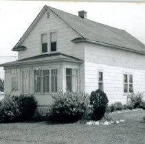 Image of Von Stowver House - This is a photograph of the front exterior of the Robert Von Stowver home located at 5318 W. 89th Street. The building was formerly located at the site of the First Congregational Church, now known as Pilgrim Faith United Church of Christ, located at 9413 S. 51st Avenue. The house was built in 1922. In 1954, when the church sought to expand its facilities, bids were taken to have the house moved or demolished. Robert Von Stowver won the bid and moved the house to its present location on 89th Street.