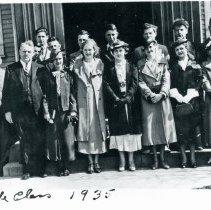 Image of Trinity Lutheran Church Bible Class - This is a photograph of the Trinity Lutheran Church Bible Class posing at the entrance of the church located at 5000 W. 95th Street. Front row, left to right; 1. Rev. J.H. Prange, 2. Viola Baike, 3. Adeline Spaeh, 4. Irene Plahm, 5. Frieda Radmacher, 6. Laura Plahm, 7. Annamae Kuhn Second row:1. John Benck, 2. unidentified, 3. Herbert Skalski, 4.Kenneth Eyers, 5. Marvin Snyder, 6. James Rathje, 7. Alfred Aulwurm, 8. Edward Reimer, Top row: Albert Norris (?)