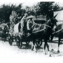 Image of Oak Lawn Round-Up Days  - This is a photograph of an old-time covered wagon of the prairie in the Oak Lawn Round-Up parade.