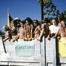 Image of Oak Lawn Round-Up Days Parade - This is a photograph of the Oak Lawn Round-Up Days Parade. It features Girl Scout Troop 249 riding in a horse drawn wagon sponsored by Fantl's Furniture Company which was located at 4905 W. 95th Street.