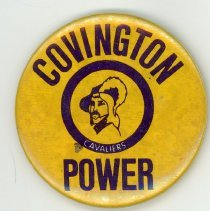 Image of Covington School Promotional Pin - This item is a pin used to promote Covington School. It is yellow in color and features the image of a caviler.