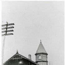 Image of Wabash Railroad Depot - This is a photograph of the exterior of Wabash Railroad Depot in Oak Lawn. Standing on platform from left to right are Enoch Tucker (father of James A. Tucker), James A. Tucker, and Harry Thornton (uncle of Ethel Piper Tucker).