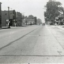 Image of 95th Street, 1937 - This is a photograph of 95th Street looking west halfway between 52nd Avenue and Cook Avenue. Several businesses are seen on both sides of the road, including Schultz's at 5220 W. 95th Street and the Sinclair gas station.Sinclair Gasoline sign at Safeway Motor Sales and Service located at 5252 W. 95th Street on the north (right) side of the street.