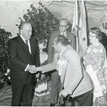 Image of Illinois Municipal League Annual Conference, 1973 - This is a photograph of the Mayors' Reception at the annual conference of the Illinois Municipal League. Left to right: Richard J. Daley, Fred M. Dumke and his wife, Martha Dumke.