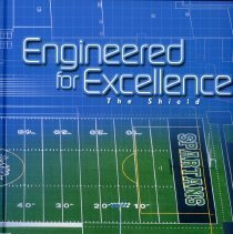 Image of Shield, 2016 - This item is an Oak Lawn Community High School yearbook from 2016.  The cover is blue and features an image of the football field.