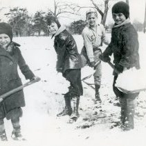 Image of 1938 Snowfall - This is a photograph of boys shoveling snow with coal scoops on the south side of 98th Street between 54th Avenue and Minnick Avenue. The snowfall was 9.1 inches. Left to right: Don Sheriff, David E. Trimble, Arthur Granat, and Jack Sheriff.