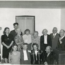 Image of 1930s Family Gathering - This is a photograph of a family gathering taken in the 1930s. Left to right, top row: Bernice Emery Mullen, Joe Mullen, Mrs. Allie Piper, Elsie Elvidge, Anna Emery, Laura Phillips, Harry Phillips, John Emery. Bottom row: Carol Ann Emery, Hazel Phillips, Reba Elvidge, Ray Emery.
