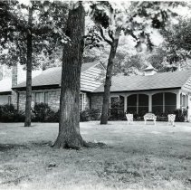 Image of Kizaric Home - This is a photograph of the front exterior of Stephen Kizaric's home located at 9250 West 53rd Court. Kizaric served as police magistrate for the Village of Oak Lawn, owned a real estate business, and was active in the Chamber of Commerce and Round-Up Days.