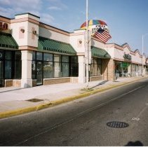 Image of 95th Street Businesses - This is a photograph of businesses on the south side of 95th Street near Cicero Avenue. The businesses includes a Mattress World store, a few empty store fronts, and Eva's Bridal. Eva's Bridal had a fire on November 17, 2010 and eventually relocated further west down 95th Street.