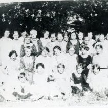 Image of Trinity Lutheran Church Ladies Aid Society - This is a photograph of the Ladies Aid Society of the Trinity Evangelical Lutheran Church. The Society was formed in 1916.  Left to right, back row: Hannah Voegle, Mrs. Frieda Krueger, Reverend Paul Brockhaus, Mrs. (Charles) Caroline or Lena Sahs, unidentified, Mrs. (Charles) Vick, Mrs. (Paul) Clara (Stender) Brockhaus, Mrs. (William) Maria (Sahs) Aulwurm, Mrs. Minnie Sahs, unidentified.  Middle row: Mrs. (Fred) Minnie Lange, Mrs. Termunde, Mrs. Hannah Krueger, Mrs. (Charles) Benck, Mrs. (Fred) Behrend.  Front row: Mrs. (Al) Elsie (Ducwitz) Aulwurm, Mrs. (William) Hilgendorf, Mrs. Mecklenburg, unidentified, unidentified, unidentified, Mrs. Jessie (Aulwurm) Vick. All others are unidentified. Photo identification and donation by Ella Aulwurm.