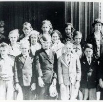 Image of Trinity Lutheran Sunday School Class - This is a photograph of the Sunday School of Trinity Evangelical Lutheran Church in the 1930s.  On the right end of the bottom row is George Benck. In the third row is Mrs. Aulwurm and Lois Prange. Photo identification and donation by Ella Aulwurm.