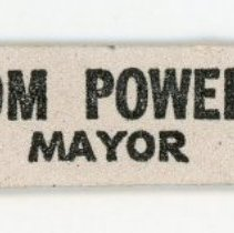 "Image of Dr. Thomas V. Powell Promotional Nail File - This item is a promotional nail file given out during the 1973 mayoral campaign for Dr. Thomas V. Powell. It is multi-colored and features the slogan ""Save Our Village"". Powell was mayor for a short time in 1973 after defeating Fred M. Dumke. The results were later reversed by a court decision and recount."