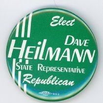 Image of Dave Heilmann Campaign Pin - This item is a pin promoting Dave Heilmann for Illinois State Representative of the 36th District. Dave was head of the Oak Lawn Park District Board and later served as mayor from 2005 - 2013. The item is green in color with white lettering.