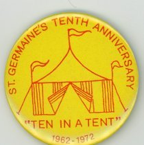 Image of St. Germaine Promotional Pin - This item is a button promoting the tenth anniversary of St. Germaine Church. It is yellow in color and features the image of a tent.