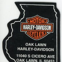 Image of Harley-Davidson Motorcycles Magnet - This item is a magnet from Harley-Davidson Motorcycles located at 11040 South Cicero Avenue in Oak Lawn. It is black in color and cut in the shape of Illinois.