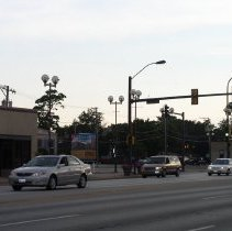 Image of 95th Street and Cook Avenue - This is a photograph of the intersection of Cook Avenue and 95th Street taken from the northeast and looking to the southwest. Traffic can be seen moving eastbound on 95th Street. Deja Brew located at 5219 W. 95th Street is in the left of the picture. A temporary building located on the southeast corner of the intersection is the sales office for the Arbor Court condominium building that now stands on the site of the former Oak Lawn School, also known as Cook School, located at 9526 S. Cook Avenue.
