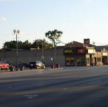 Image of 95th Street and 53rd Avenue - This is a photograph of the intersection of 95th Street and 53rd Avenue taken from the north side of 95th Street and looking southwest. Businesses along the 5300 block included Joon Lee's Tae Kwon Do Academy, St. James Place, and Dolores Interiors.