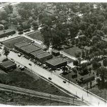 Image of Aerial Photograph of 95th Street, 1949 - This is an aerial view photograph of 95th Street east of the Wabash Railroad. Brandt Avenue is in the upper left corner, and moving right are 50th Court and 51st Avenue. The Oak Lawn Savings and Loan building located at 5015 W. 95th Street is visible at the corner of 50th Court and 95th Street. In the lower right corner of the picture, part of the William Brandt & Son Coal and Building Materials yard is visible.