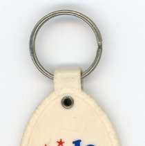 Image of Colonial Savings Bank Key Chain - This item is a keychain given out by Colonial Savings Bank located near 95th Street and Southwest Highway in Oak Lawn. It is white in color and features an emblem celebrating the 1976 American Bicentennial.