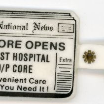 Image of Christ Community Hospital Key Chain - This item is a keychain given out by Christ Community Hospital in Oak Lawn. It is in the shape of a newspaper and highlights the opening of an outpatient center.