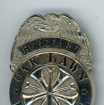 Image of Honorary Oak Lawn Fire Department Badge - This item is an honorary Oak Lawn Fire Department Badge. It features an eagle at the top and emblem in the center.