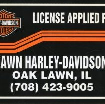 Image of Harley-Davidson Promotional License Plate  - This item is a promotional license plate from Harley-Davison Motorcycles located at 11040 South Cicero Avenue in Oak Lawn. It is primarily black in color and features a logo at the top left.