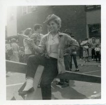 Image of Oak Lawn Round-Up Days - This is a photograph featuring an unidentified woman participating in the Oak Lawn Round-Up Days celebration. She is holding a pistol and dressed in Western themed clothing.