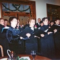 Image of Voice of the Valley Community Choir - This is a photograph of the Voices of the Valley, a community choir sponsored by the Oak Lawn Park District, performing at a fundraising campaign reception held at the Oak Lawn Hilton November 8, 2001 for the Oak Lawn Children's Museum.