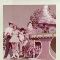 Image of Oak Lawn Round-Up Days - This is a photograph featuring the Oak Lawn Roller Rink float in the annual Round-Up parade. A number of individuals are seated on the float as it moves down 95th Street near 55th Court. Businesses such as Zale's Frozen Custard (5540 West 95th Street) are visible in the background.