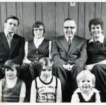 "Image of Sinclair ""Bud"" Randall Family - This is a photograph featuring Sinclair ""Bud"" Randall, Oak Lawn resident and candidate for reelection to Village Trustee Board. Pictured left to right are Mr. Randall's son, John; Mr. Randall's wife, Betty; Sinclair ""Bud"" Randall; and his daughter-in-law, Barbara. Seated in front of them are the candidate's grandchildren, Linda, Lara, and James."