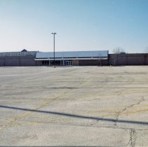 Image of Shuttered K-Mart Store - This is a photograph featuring a shuttered K-Mart store formerly located at 4104 W. 95th Street. The Oak Lawn Holiday Inn, formerly located at 4140 W. 95th Street is visible in the background.