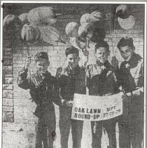 Image of Oak Lawn Round-Up Days - This is a photograph of Boy Scouts from Troop 619 sponsored by St. Gerald School selling balloons during Oak Lawn Round-Up Days. From l-r are David Carlson, age 12; Richard Bachert, age 12; Ronald Kasch, age 12; and Peter Bulow, age 13.