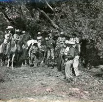 Image of Round-Up Days, 1952 - This is a photograph of the results of a public hanging of 'Horse Thief Harry' during Round-Up Days in Oak Lawn. Held from 1949-1958, the Round-Up was a western themed celebration that included a parade, rides, and other events.