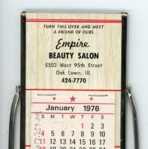 Image of Empire Beauty Salon Calendar  - This item is a calendar given out by the Empire Beauty Salon located at 5503 West 95th Street in Oak Lawn. It is white and red in color and the back features a mirror.