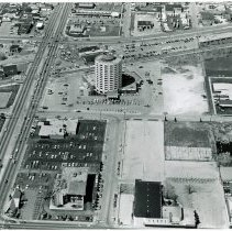 Image of Aerial Photograph of Cicero Avenue at 95th Street - This is an aerial photograph of Cicero Avenue looking north from 95th Street. The intersection of 95th at Cicero is seen in the very left bottom of the photograph. Cicero Avenue is seen running from the top (north) of the photo to the bottom (south) of the photo along the left side. Pete George's Chevrolet located at 9440 S. Cicero is partially visible on the left. The IHOP restaurant located at 4744 W. 95th Street is visible on the northeast corner of the intersection. The Papachino Restaurant and Lounge is located just north of the pancake house at 9401 S. Cicero Avenue/ in Oak Lawn. The Oak Lawn Hilton Inn located at 94th Street and Cicero Avenue and Kole Pontiac located at 9301 S. Cicero are visible farther to the north. Southwest Highway is visible running from the left (west) to the right (east) across the top of the photo. St. Paul Lutheran Church & School, located at 4660 W 94th Street, is partially visible in the right center of the photo. The Coral Theatre located at 4720 West 95th Street near Cicero Avenue is in the bottom middle of the photo. The Talman Home bank building located 4740 W. 95th is just west (left) of the theatre.