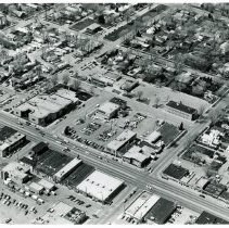 Image of Aerial Photograph of 95th Street between 52nd Avenue and 53rd Court - This is an aerial photograph of 95th Street between 52nd Avenue and 53rd Court. 95th Street is seen diagonally from the left (west) to the right (east) in the lower part of the photo. 52nd Avenue is seen diagonally from the middle bottom (south) to the upper right (north) in the photo. The Zimmerman and Sandeman Memorial Chapel, located at 5200 W. 95th Street, is visible on the northwest corner of the intersection of 95th Street and 52nd Avenue. To the north, the Oak Lawn Masonic Temple, located at 9420 S. 52nd Avenue, is on the northwest corner of 52nd Avenue and Dumke Drive. The Village Hall, located at 5252 Dumke Drive, is seen just to the west (left) of the Temple. The Oak Lawn Police and Fire Departments, located at 9437 S. Cook Avenue, are seen on the southeast corner of Dumke Drive and Cook Avenue. The Oak Lawn Public Library, located at 9427 S. Raymond, is just left (west) of the police and fire building. To the left (west) of the library, the Behrend home, located at 9446 S. Raymond Avenue is seen, as are many mobile homes in the Pine Tree mobile home park that occupied space between Raymond Avenue and 53rd Court. To the north of the mobile home park, the Oak Lawn Green Oak Post 757, located at 9354 S. 53rd Avenue, occupies the northwest corner of the intersection of 53rd Avenue and Oak Street. The O'Brien home, located at 9402 S. 53rd Court, is visible in the upper left hand corner of the photo, on the southwest corner of the intersection of Oak Street and 53rd Court.