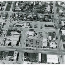 Image of Aerial Photograph of 95th Street between 52nd Avenue and Raymond Avenue - This is an aerial photograph of 95th Street between 52nd Avenue and Raymond Avenue looking from the south to the north. 95th Street is seen from the left (west) to the right (east) in the lower part of the photo. 52nd Avenue is seen from the right bottom (south) to the upper right (north) in the photo. The Zimmerman and Sandeman Memorial Chapel, located at 5200 W. 95th Street, is visible on the northwest corner of the intersection of 95th Street and 52nd Avenue. To the north, the Oak Lawn Masonic Temple, located at 9420 S. 52nd Avenue, is on the northwest corner of 52nd Avenue and Dumke Drive. The Village Hall, located at 5252 Dumke Drive, is seen just to the west (left) of the Temple. The Oak Lawn Police and Fire Departments, located at 9437 S. Cook Avenue, are seen on the southeast corner of Dumke Drive and Cook Avenue. The Oak Lawn Public Library, located at 9427 S. Raymond, is just left (west) of the police and fire building. To the left (west) of the library, the Behrend home, located at 9446 S. Raymond Avenue is seen, as are many mobile homes in the Pine Tree mobile home park that occupied space between Raymond Avenue and 53rd Court. To the north of the mobile home park, the Oak Lawn Green Oak Post 757, located at 9354 S. 53rd Avenue, occupies the northwest corner of the intersection of 53rd Avenue and Oak Street.