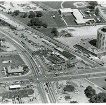 Image of Aerial Photograph of Cicero Avenue at Southwest Highway - This is an aerial photograph of Cicero Avenue at Southwest Highway. Cicero is visible from the left (north) to the right (south) near the bottom of the picture. Southwest Highway is visible from the top (northeast) to the bottom (southwest) in the middle of the photo. Vehicle traffic is visible on both roads. Businesses seen clockwise from the bottom include the Economy Services station and car wash, located at 9266 S. Cicero on the northwest corner of the intersection; the Sizzler Family Steak House, located at 9267 S. Cicero Avenue, on the northeast corner of the intersection; Kole Pontiac, located at 9301 S. Cicero, on the southeast corner of the intersection; and a Union 76 gas station, located at 9300 S. Cicero Avenue, on the southwest corner of the intersection. Prince Castle, located at 4817 93rd Street is visible behind the Union 76 station. The Sheraton Tower (now known as the Oak Lawn Hilton) located at 9333 S. Cicero Avenue, is visible just south of the railroad tracks. St. Paul Lutheran Church and School, located at located at 4660 W 94th Street is seen just east of the Sheraton. The D-Lux Motel located at 4811 W. Columbus is visible slightly west and north of the railroad tracks. The words Unique Lounge can be seen spelled out on the roof of the motel.