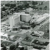 Image of Aerial Photograph of Christ Community Hospital  - This is an aerial photograph of Christ Community Hospital (now known as Advocate Christ Medical Center) located at 4400 W. 95th Street seen from the southeast and looking northwest. 95th Street is seen diagonally from left (west) to right (east) across the lower portion of the picture. Kostner Avenue is seen from the bottom left corner (south) to the upper right (north) in the photo. The original hospital building is back building located in an east/west position. The newer building is in front in a north/south attitude connected to the older building by a glass enclosed walk way. A parking structure is visible along the west side of Kostner Avenue. New construction can be seen taking place on the southeast side of the campus. This building is a Physcians Pavilion. The Rotunda Medical Building, located on the northeast corner of 95th Street and Pulaski was demolished in 2015. Many other changes have taken place on the campus including the construction of several other additions one of which is the Advocate Children's Hospital, located on the northeast corner of the campus at Kostner Avenue and 93rd Street.