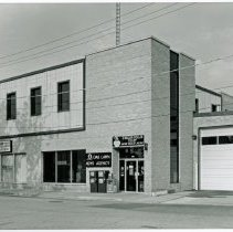 Image of 9500 Block of Cook Avenue, 1987 - This is a photograph featuring a view of Exline and Associates Real Estate Consultants located at 9515 S. Cook Avenue and the Oak Lawn News Agency located at 9517 S. Cook Avenue.