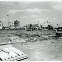 Image of 95th Street and Cicero Avenue - This is a photograph featuring a view of the intersection of 95th Street and Cicero Avenue taken from the southwest and looking northeast. Construction on the southwest corner of the intersection is visible. Brick and building materials are seen on the site. A sign on the building on the left indicates that the entrance to Super Cuts, located at 9532 S. Cicero, is just to the south. Pete Georges Chevrolet located at 9440 S. Cicero Avenue occupies the northwest corner of the intersection. The Hilton Inn of Oak Lawn, located at 94th & Cicero is seen in the background. Delray Farms Fresh Market and Brueggers Bagels, located at 4742 W. 95th Street, are partially visible behind the semi-truck moving south on Cicero Avenue. Coral Plaza, located just east of Cicero Avenue on 95th Street is also partially visible. The International House of Pancakes, located at 4744 W. 95th Street occupies the northeast corner of the intersection. A year later, Brueggers Bagels, Delray Farms, and the pancake house were all demolished and a Walgreens was built on that corner. White Castle located at 9501 S. Cicero Avenue occupies the southeast corner of the intersection. A sign on the building indicates that the restaurant is open during construction.