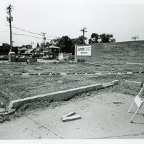 Image of 95th Street and Cicero Avenue - This is a photograph featuring a view of a construction project on the southwest corner of the intersection of 95th Street and Cicero Avenue. Brick and building materials are seen on the site. A sign on the building on the left indicates that the entrance to Super Cuts, located at 9532 S. Cicero, is just to the south. Ticor Title, located at 9524 S. Cicero Avenue, is seen in the background. Two men are seen standing in the parking lot near the construction site.