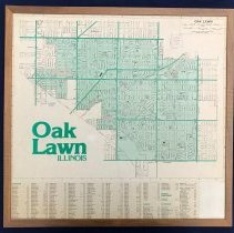 Image of 1980 Map of Oak Lawn - This item is a Profile Publications map of Oak Lawn printed in 1980 and mounted in a brown frame.  There is a street key at the bottom, and the city limits of Oak Lawn are shaded in green.