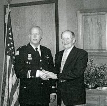 Image of Smith and Kolb - This is a photograph of  Detective Division Commander Robert V.Smith and Mayor Ernest Kolb in March of 2002, just prior to Smith's promotion to Chief of Police.