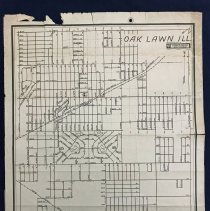 Image of 1945 Map of Oak Lawn - This item is a map of Oak Lawn prepared by Sidwell Studios in 1945.  It has a street index at the bottom, several holes at the top (indicating it was bound at some point), along with writing on the back.