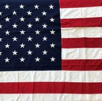 Image of United States Flag  - This item is a United States Flag (50 stars) flown over the Oak Lawn Village Hall following the 1967 Tornado. It was obtained from Chicago and given to the Village in the aftermath of the storm.