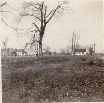 Image of 51st Avenue at 94th Street, 1916 - This is a photograph featuring a view looking north on 51st Avenue from 94th Street in 1916. Several homes can be seen in the area.
