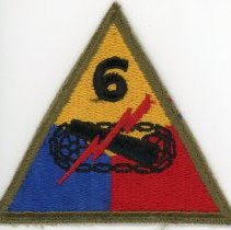Image of 6th Armored Division Patch  - This item is a patch from the 6th Armored Division used during World War II. It is yellow, blue, and red in color and features a lighting bolt across the center. Originally formed in early 1942, the division served primarilly in Europe during the war.