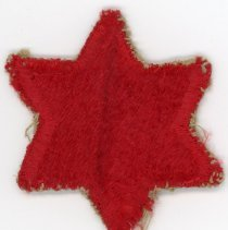 Image of 6th Infantry Division Patch  - This item is a patch from the 6th Infantry Division used during World War II. It is red in color and shaped like a six pointed star. Reactivated in 1939, the division served in the Pacific Theatre during the war.