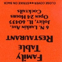 Image of Family Table Restaurant Matchbook - This item is a matchbook for the Family Table Restaurant located at 6616 West 95th Street in Oak Lawn. It is orange in color and features black lettering. The restaurant also had a location in Joliet.